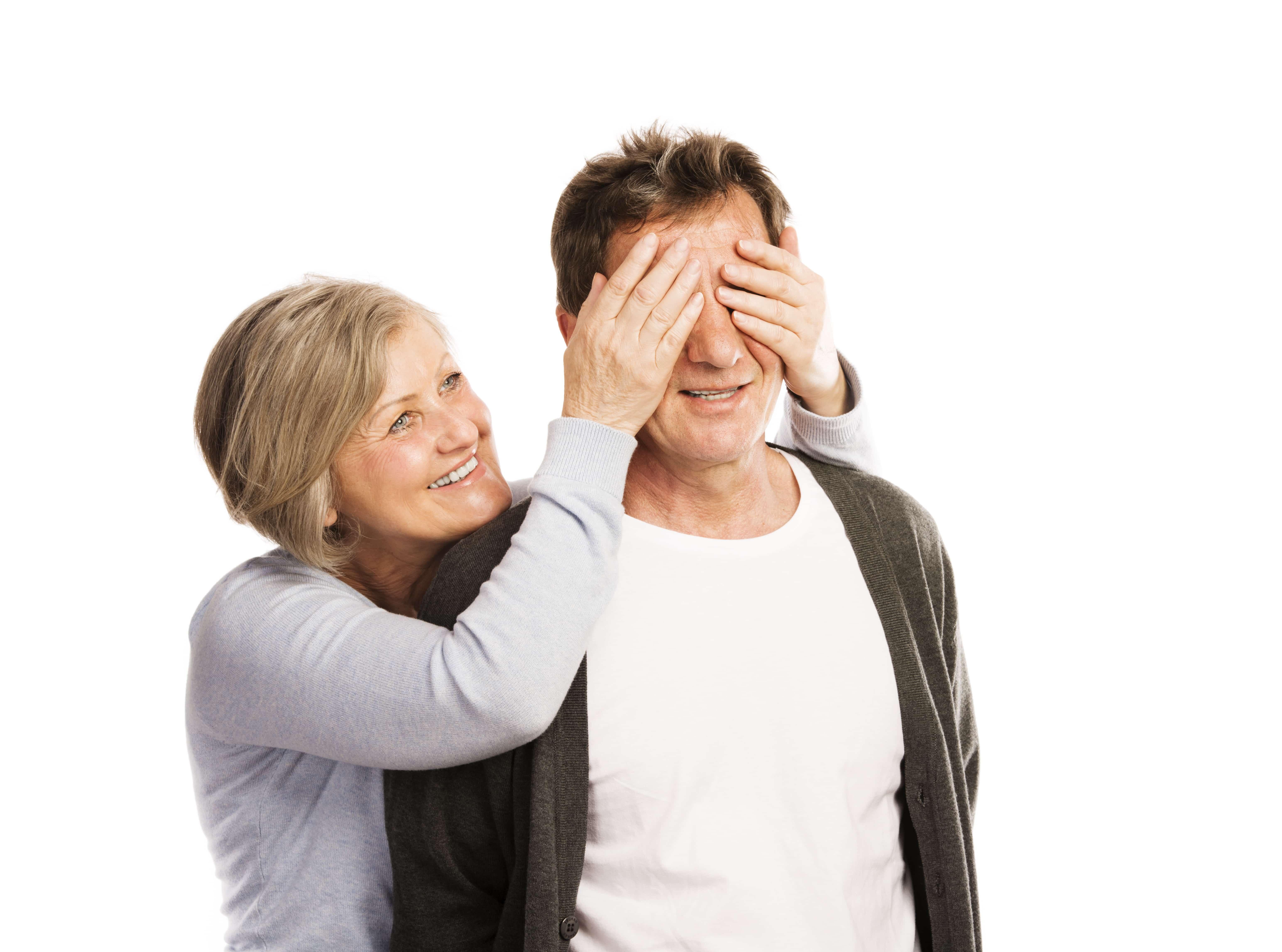 Studio portrait of happy seniors couple having fun. Isolated on white background.